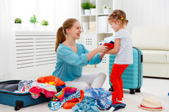 Happy family mother and child daughter suitcases packed for vaca Royalty Free Stock Image