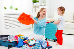 Happy family mother and child daughter suitcases packed for vaca Stock Photography