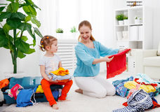 Happy family mother and child daughter suitcases packed for vaca Stock Image