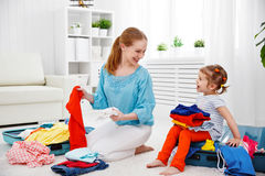 Happy family mother and child daughter suitcases packed for vaca Royalty Free Stock Photography