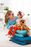 Happy family mother and child daughter suitcases packed for vaca Stock Photo