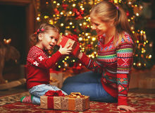 Happy family mother and child girl  with Christmas present Royalty Free Stock Photos