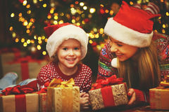 Happy family mother and child girl  with Christmas present Royalty Free Stock Images