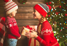 Happy family mother and child girl  with Christmas present Stock Photos