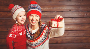 Happy family mother and child girl  with Christmas present Stock Images