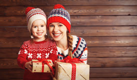 Happy family mother and child girl  with Christmas present Stock Photography