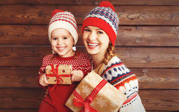 Happy family mother and child girl  with Christmas present Stock Photo