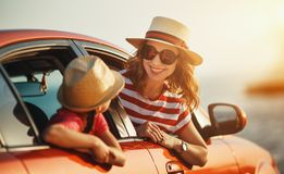 Happy family mother and child girl goes to summer travel trip in car royalty free stock images