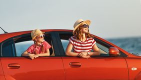 Happy family mother and child girl goes to summer travel trip in car stock photos