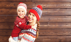 Happy family mother and child girl  hugs at wooden background Stock Images