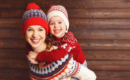 Happy family mother and child girl  hugs at wooden background Stock Photos