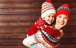 Happy family mother and child girl  hugs at wooden background Stock Photo