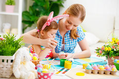 Happy family mother and child girl paints eggs for Easter Royalty Free Stock Photography