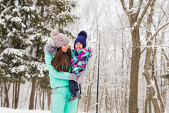Happy family. Mother and child girl on a winter walk in nature. stock photography