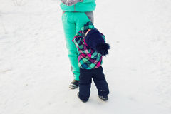 Happy family. Mother and child girl on a winter walk in nature. Happy family. Mother and child girl on a winter walk in nature Royalty Free Stock Image