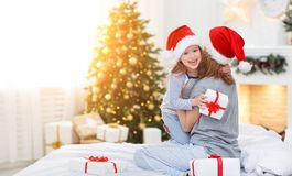 Happy family mother and child hugging and giving gifts  on Chris Stock Image