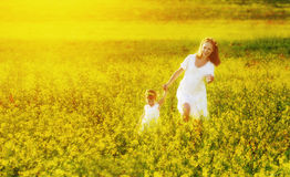 Happy family, mother and child l little daughter running  on mea Royalty Free Stock Photography