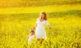 Happy family, mother and child l little daughter running  on mea Stock Photo