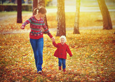 Happy family mother and child little daughter on autumn walk. Happy family mother and child little daughter running and playing on autumn walk Royalty Free Stock Images