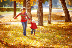 Happy family mother and child little daughter on autumn walk. Happy family mother and child little daughter running and playing on autumn walk Royalty Free Stock Photos