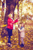 Happy family mother and child little daughter on autumn walk. Happy family mother and child little daughter running and playing on autumn walk Stock Image