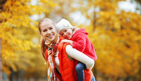 Happy family. mother and child little daughter play on autumn. Walk in nature outdoors Royalty Free Stock Images