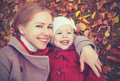 Happy family: mother and child little daughter play cuddling on autumn. Walk in nature outdoors Royalty Free Stock Image