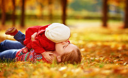 Happy family: mother and child little daughter play cuddling on Stock Image