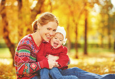 Happy family: mother and child little daughter play cuddling on. Autumn walk in nature outdoors Stock Images
