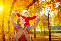 Happy family: mother and child little daughter play cuddling on Royalty Free Stock Image