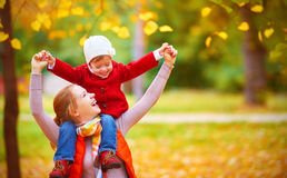 Happy family: mother and child little daughter play cuddling on. Autumn walk in nature outdoors Royalty Free Stock Photo