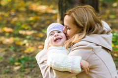 Happy family: mother and child little daughter Royalty Free Stock Photos