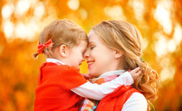 Happy family. mother and child little daughter play kissing on a Stock Images