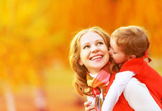 Happy family. mother and child little daughter play kissing on a Royalty Free Stock Photography