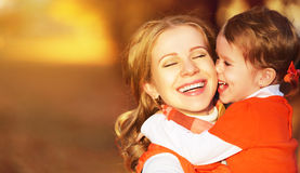 Happy family. mother and child little daughter play kissing on a. Utumn walk in nature outdoors Stock Photography