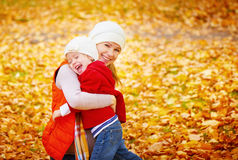 Happy family: mother and child little daughter play, laughing cu Stock Photos