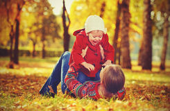 Happy family: mother and child little daughter playing and laughing in  autumn Royalty Free Stock Images