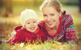 Happy family: mother and child little daughter playing and laughing in  autumn Stock Photos
