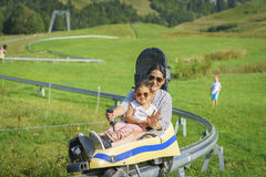 Happy family mother and child little daughter in Summer toboggan stock image