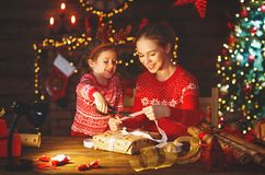 Happy family mother and child pack Christmas gifts Stock Image