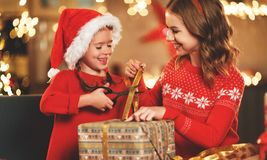 Happy family mother and child pack Christmas gifts stock photography