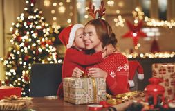 Happy family mother and child pack Christmas gifts royalty free stock photography