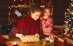 Happy family mother and child pack Christmas gifts Royalty Free Stock Images