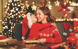 Happy family mother and child pack Christmas gifts stock photos