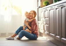 Happy family mother and child son hugging stock images