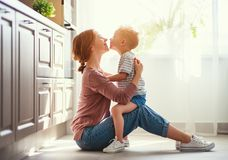 Happy family mother and child son hugging royalty free stock photography