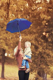 Happy family mother and child with umbrella in autumn Stock Image
