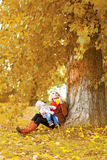 Happy family, mother and child walking in autumn season Royalty Free Stock Photo