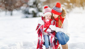 Happy family mother and child on winter walk drinking tea. Happy family mother and child daughter on a winter walk outdoors drinking tea stock photo