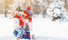 Happy family mother and child on winter walk drinking tea Royalty Free Stock Photography